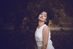 Selective Focus Photography of Woman in White Crew-neck Sleeveless Dress stock images
