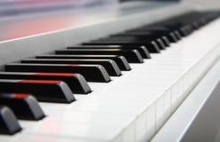 Selective focus of a piano keyboard closeup. Selective focus of a piano keys closeup Stock Images