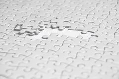 Selective focus of pieces white jigsaw puzzle, Business solution. Concept, collaborate concept Royalty Free Stock Image