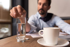 Selective focus of a pill being put in water Stock Photo