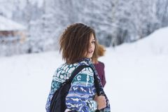 Selective Focus Portrait Photograph of Woman Wearing Blue, Green, and White Tribal Jacket and Black Backpack Outfit Royalty Free Stock Photography