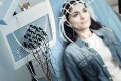 Selective focus of a professional diagnostic device. Modern electroencephalography. Selective focus of professional diagnostic device being used for monitoring stock image