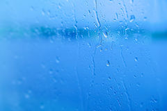 Selective focus, Raindrops on glass with city Royalty Free Stock Image