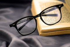 Selective focus of reading Eyeglasses wiht opened book Royalty Free Stock Photos