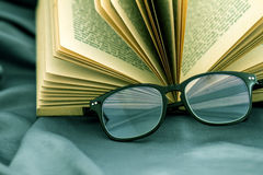 Selective focus of reading Eyeglasses wiht opened book Stock Photos