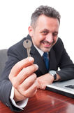 Selective focus of real estate man holding key. Isolated on white background Royalty Free Stock Photography