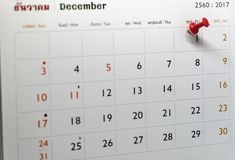 Selective focus of a red push pin marking on calendar date royalty free stock images