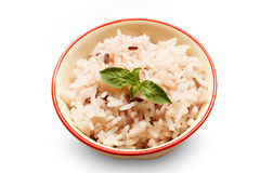 Selective focus rice,leaf in bowl on white background. Royalty Free Stock Photo