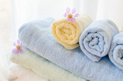 Selective focus of rolled bath towels at home Stock Photos
