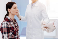 Selective focus of a scalpel being given to the doctor Stock Photos