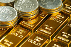 Selective focus on shiny gold bars with stack of coins as busine. Ss or financial investment and wealth concept Stock Photography