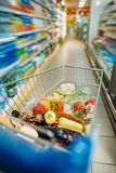 shopping cart with purchases in supermarket Stock Photography