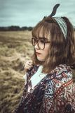 Selective Focus Shot of Woman in White and Brown Floral Standing on Grass Field Stock Photography