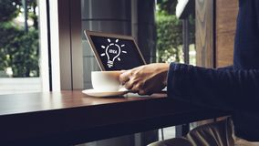Selective focus of Side view laptop is on the work table in a conner office. With morning light. idea concept Royalty Free Stock Images