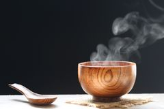 Selective focus of smoke rising with hot soup in cup on dark backgroundSelective focus of smoke rising with hot soup in cup on. Selective focus of smoke rising royalty free stock photography