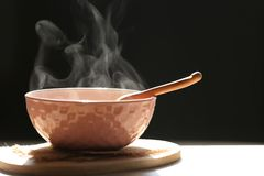 Selective focus of smoke rising with hot soup of instant noodles royalty free stock images