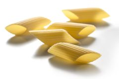 Some pieces of big pasta isolated on white background. Selective focus on Some pieces of big pasta isolated on white background stock photography