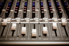 Selective focus sound mixer background. Royalty Free Stock Photos