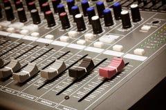 Selective focus sound mixer background. Royalty Free Stock Photos