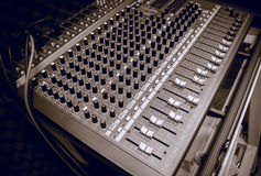 Selective focus sound mixer background. Royalty Free Stock Photo