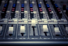 Selective focus sound mixer background. Royalty Free Stock Photography