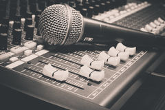 Selective focus sound mixer and blur microphone  background. Royalty Free Stock Photos