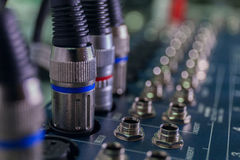 Selective focus of sound mixer close up cables macro Stock Photo