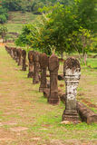 Selective focus of stone carved poles columns along walking path Royalty Free Stock Photography