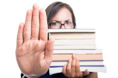 Selective focus student girl holding books showing stop Stock Photography