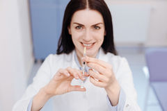 Selective focus of syringe being held by a doctor Royalty Free Stock Images