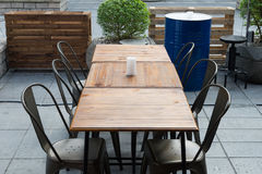 Selective focus of table of coffee shop outside view Royalty Free Stock Photos