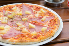 Selective focus. Tasty pizza with ham and cheese. Royalty Free Stock Photo
