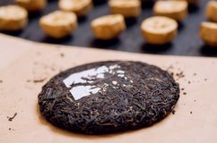 Selective focus on Tea cake, traditional chinese puer drink in different sorts. Popular antioxidant from China. Selective focus on Tea cake, traditional chinese Royalty Free Stock Photography