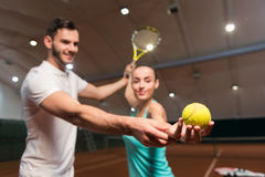 Selective focus of tennis ball in players hand Stock Image