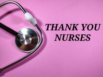 Selective focus.Text THANK YOU NURSES on pink background with stethoscope.Medical concept.