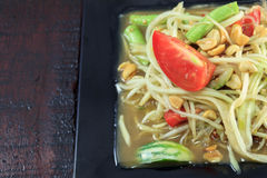 Selective focus Thai food the papaya salad or somtum in dish on. Wood background stock photos