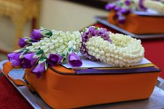 Selective focus on Thai jasmine and purple rose garland.  Royalty Free Stock Photography