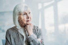 selective focus of thoughtful senior woman stock photo