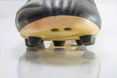 Selective focus to button of soccer shoes Royalty Free Stock Photography