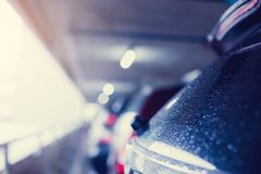 Selective focus to rain water drops on black car texture. royalty free stock photo