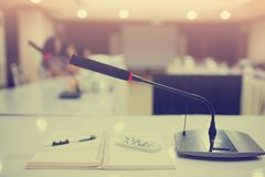 Selective focus to wireless conference microphones stock photos