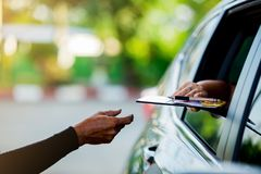 Selective focus to woman pay credit card with staff for fuel. royalty free stock images