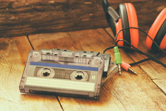 Selective focus of top view of vintage headphones and cassettes Stock Photos
