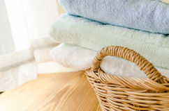 Selective focus of towels in wicker basket at home Stock Image
