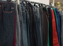 Selective focus various jean on rack. Royalty Free Stock Images