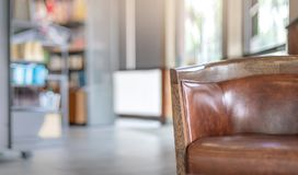 Selective focus of vintage leather chair in coffee shop Royalty Free Stock Image