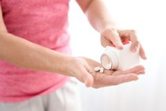 White pill on woman hand royalty free stock photos