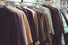 Selective focus winter coats hanged on a clothes rack.  Stock Images