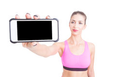 Selective focus of woman sport trainer holding telephone Royalty Free Stock Images