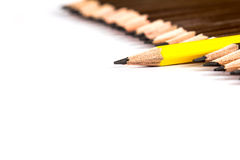 Selective focus of wooden pencil arrange  with one different. Selective focus of  the wooden pencil arrange  with one different as a symbol of difference concept Stock Photo